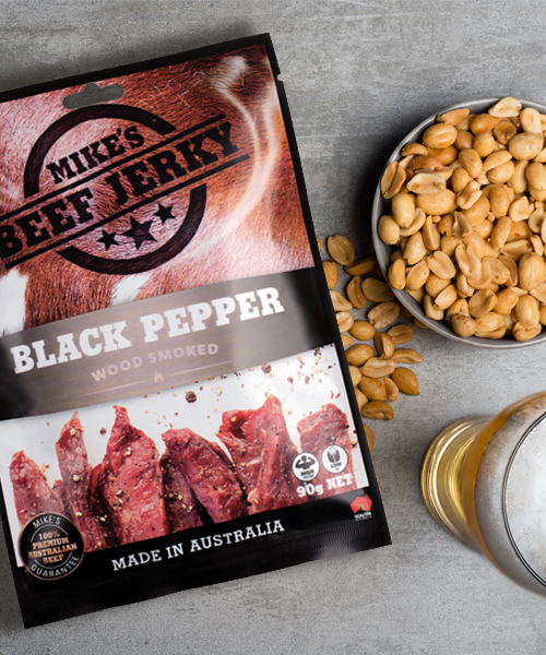 Mike's Beef Jerky. Arial photo of front of pack next to a bowl of nuts and a glass or beer.